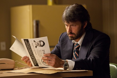 Tony Mendez (Ben Affleck) looks through some important documents while plotting to secure the release of American diplomats being held hostage in Iran.