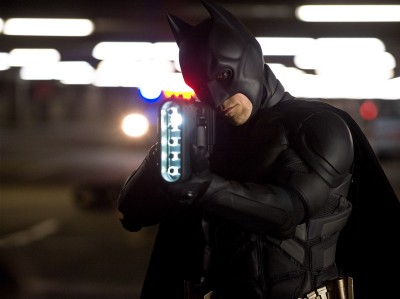 "Christian Bale returns as Batman, setting a record for film portrayals of the Caped Crusader in ""The Dark Knight Rises."""