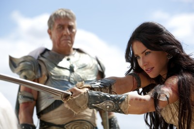 Barsoomian princess Deja Thoris (Lynn Collins) wields a sword in front of Tardors Mors (Ciar�n Hinds).