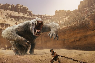 With the giant White Ape behind him, John Carter (Taylor Kitsch) pulls on a chain.