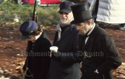 Steven Spielberg directors Daniel Day-Lewis, fully costumed as Abraham Lincoln.