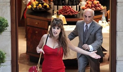 "An irritated Penelope Cruz runs out to the street in Woody Allen's ""Nero Fiddled."""
