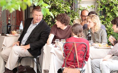 Alec Baldwin shares some words with a table seating Jesse Eisenberg, Greta Gerwig, and Ellen Page.