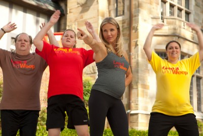 A pregnant Cameron Diaz leads a weight loss class that would appear to also be a reality television series.