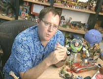 "Director John Lasseter amidst a toy-filled environment in ""Behind the Scenes of A Bug's Life."""