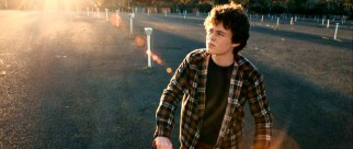 Billy Conway (Harrison Gilbertson) stops his bike at the drive-in theater where his family spent its final night intact.