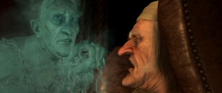 Scrooge is visited by his old partner Jacob Marley (Gary Oldman), seven years dead, in one of the film's first most frightening scenes.