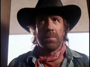 "We get our very first close-up of Cordell Walker (Chuck Norris) looking tough in the double-length pilot ""One Riot, One Ranger."""