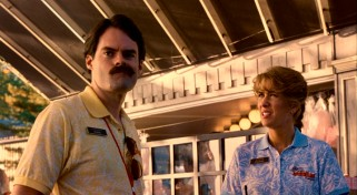 Adventureland Junior Manager Bobby (Bill Hader) snarls his mustache while he and Paulette (Kristen Wiig) decide what to do with a corn dog delivery that's been unrefrigerated for a day.