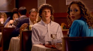 James' (Jesse Eisenberg) date with the turquoise-blazered Lisa P. (Margarita Levieva) gets an unexpected visit from a certain crotch-punching rides operator named Frigo.