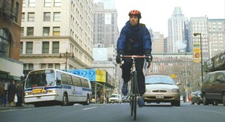 This smug bike messenger, known as 'Yac', is at work on the streets of Manhattan.