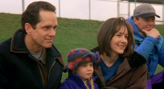 Mom's new boyfriend Patrick Sullivan (Gregory Harrison) enjoys watching Josh and Buddy play football with Jackie (Cynthia Stevenson) and her daughter Andrea (Alyson MacLaren).