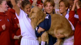 Brandi Chastain leaves her shirt on, as does teammate Tisha Venturini, to celebrate Buddy's World Cup-winning stop. Yes, the dog is apparently allowed to goaltend for the U.S. Women's Soccer Team.