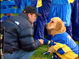 Buddy, or rather one of the five dogs that play him, gets the honor of shaking director Bill Bannerman's hand in the production featurette.