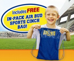 This blonde boy heartily approves the inclusion of an in-pack Air Bud: World Pup sports cinch bag.