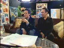 Scott Weinger and Gilbert Gottfried hang out backstage in the Green Room.