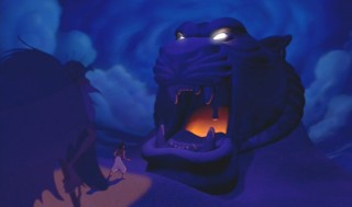 Aladdin approaches the Cave of Wonders with caution.
