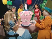 The Virtual Wonderland Party isn't so much virtual as it is watching Alice, the Mad Hatter, and three unnamed children marvel at an unbirthday cake.