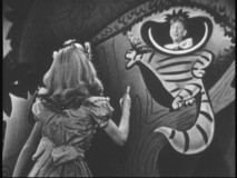 "Kathryn Beaumont and Sterling Holloway reprise their roles as Alice and the Cheshire Cat in this excerpt from ""The Fred Waring Show."""