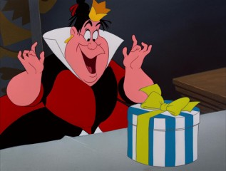 The Queen of Hearts gleefully admires her unbirthday present, unaware of the chaos that opening it will create.