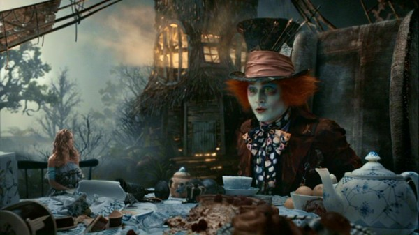 Alice's size issues continue as, shrunken, she stands only slightly taller than the teapot at the Mad Hatter's (Johnny Depp) tea party.