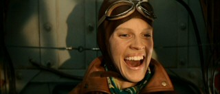 Upon her accomplishment of flying across the Atlantic Ocean solo, Amelia (Hilary Swank) is overcome with emotion.