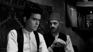Paterfamilias Isaac (Harry Davis) entrusts young Stavros (Stathis Giallelis) with the Topouzoglou family's rugs and other valued possessions.
