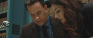 Robert Langdon (Tom Hanks) and Vittoria Vetra (Ayelet Zurer) examine Galileo's 'Dialogue Concerning the Two Chief World Systems' for clues as to where to begin their race against the clock.