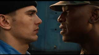 Jake engages in a staredown, with his commanding officer Cole (Tyrese Gibson), a hard-nosed Marine.