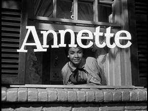 "Annette Funicello, playing Annette McCleod, smiles from her character's bedroom window as the serial's title -- what else, but ""Annette"" -- is displayed."