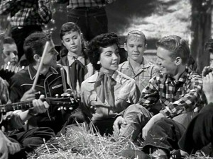 "Come on, it's lovely weather for a hayride together with you! At the encouragement of the gang, Annette reprises her party song ""How Will I Know My Love"" with a little more oomph. And just like that, a musical career was born."