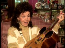 "Seen here in the 1993 featurette ""Musically Yours, Annette"", Annette Funicello is jazzed to rediscover her old Mickey Mouse Club guitar."