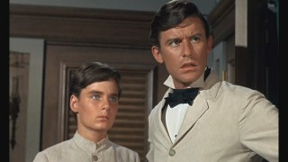 Jack Flagg (Bryan Russell) and Griffin (Roddy McDowall) find themselves on a ship destined for San Francisco.