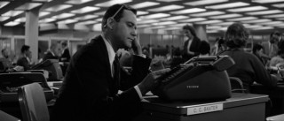 C.C. Baxter (Jack Lemmon) spends another day at his desk in a seemingly endless office.