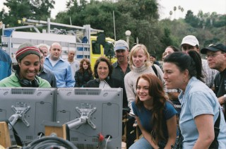 Director Angela Robinson (in ski cap) and Lindsay Lohan watch a scene on the set's monitors.