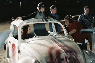 "Angela Robinson provides direction to Lindsay Lohan and Jimmi Simpson during filming of ""Herbie: Fully Loaded""'s demolition derby scene."