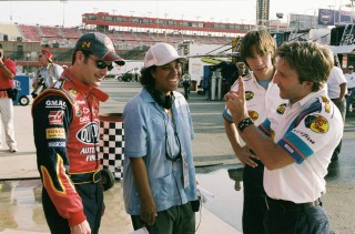 From left to right: Jeff Gordon, Angela Robinson, Justin Long, and Breckin Meyer collaborate during filming of the climactic NASCAR scenes.