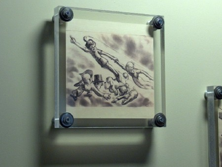 "Framed artwork from ""Peter Pan."""