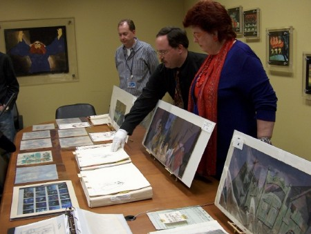 "Another table full of ""Lady and the Tramp"" art. Vice President of DVD Production David Jessen appears on the far left."