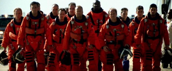"The Texas oil diggers hired to save the world make a heroic stroll in slow motion. Seen here, left to right: Owen Wilson, Ben Affleck, Greg Collins, Steve Buscemi, Ken Hudson Campbell, Bruce Willis, Michael Clarke Duncan, Will Patton, William Fichtner, Grayson McCouch, and Clark Brolly. Is it possible to make an astronaut film without paying homage to ""The Right Stuff""? Probably, but don't expect that from Michael Bay."