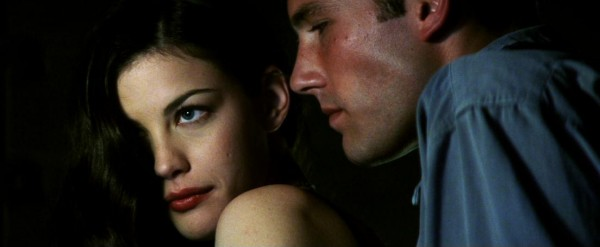 Young lovers Grace Bucket (Liv Tyler) and A.J. Frost (Ben Affleck) share a private moment, though it isn't long before Harry stops by to check on them.