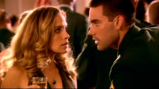 Trevor (Drew Fuller) agitatedly whispers advice to Roxy (Sally Pressman) at their first army banquet.