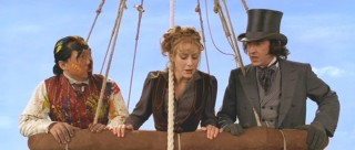 Passepartout, Phileas Fogg, and Monique go up in a hot air balloon.