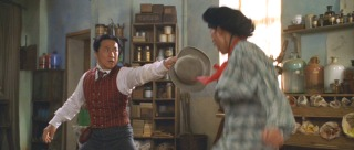 Passepartout (Jackie Chan)uses the power of his tophat to defeat an Asian bad guy.