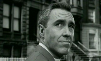 A changed man? Murray Burns (Jason Robards) takes a look up at the neighborhood he's often shouted at in one of the film's closing shots.
