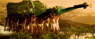 "Newly-drafted soldiers carry the Statue of Liberty on their shoulders while wearing underwear in one of the many visually imaginative sequences of ""Across the Universe."""