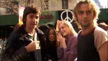 "Four of the ""Stars of Tomorrow"" -- Jim Sturgess, T.V. Carpio, Evan Rachel Wood, and Joe Anderson -- chillax during a break in filming a peace demonstration scene."