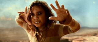 Aborigine preteen Brandon Walters earned Oscar buzz with his very first piece of acting as half-caste boy Nullah. Here, Nullah tries to ward them cheeky bulls away from a cliff with his magical hands.