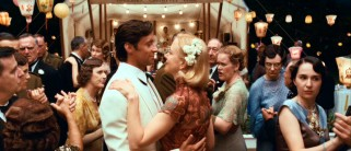 "If you thought that Baz Luhrmann got romance out of his system with ""Strictly Ballroom"", ""Romeo + Juliet"", and ""Moulin Rouge!"", then you thought wrong. Sarah (Nicole Kidman) dances with a cleaned-up Drover (Hugh Jackman) at a fancy social function."