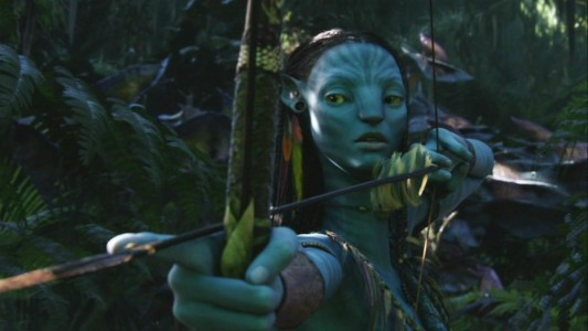 Female Na'vi Neytiri (Zoe Saldana) first comes upon Jake in the forest, bow ready.